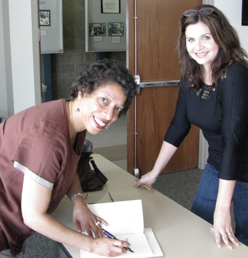 Lynne Thompson signing book for Chapman U MFA student