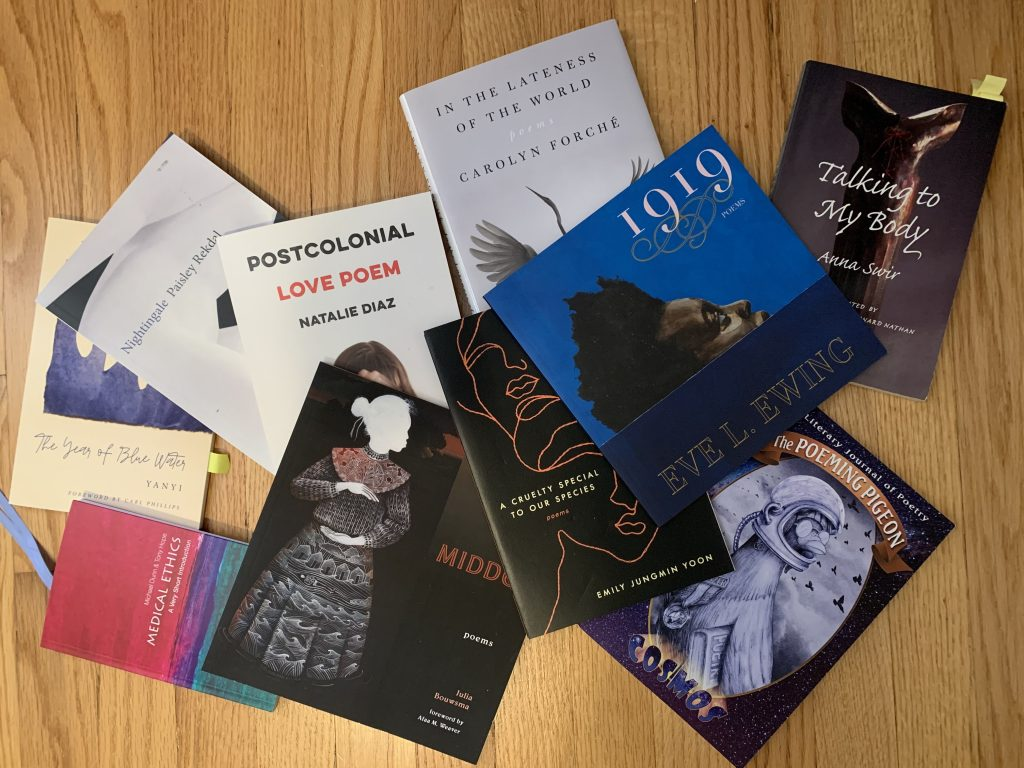 poetry books spread on the floor, with one medical ethics book